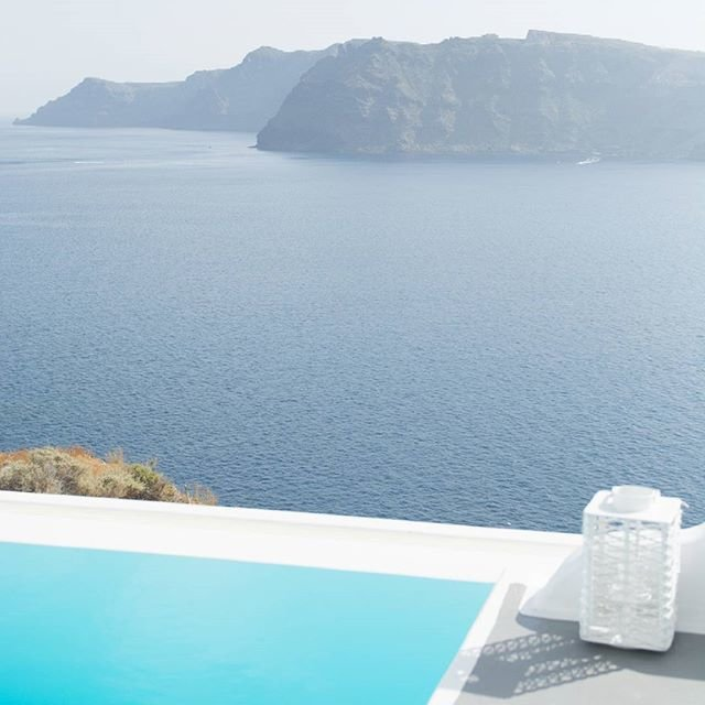 santorini pool with mountain view