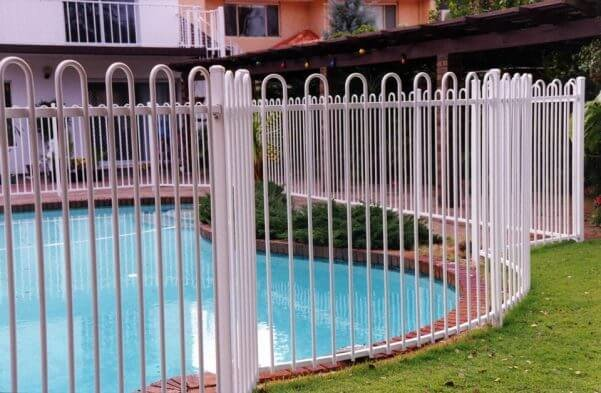 White aluminium pool fence with lop top.
